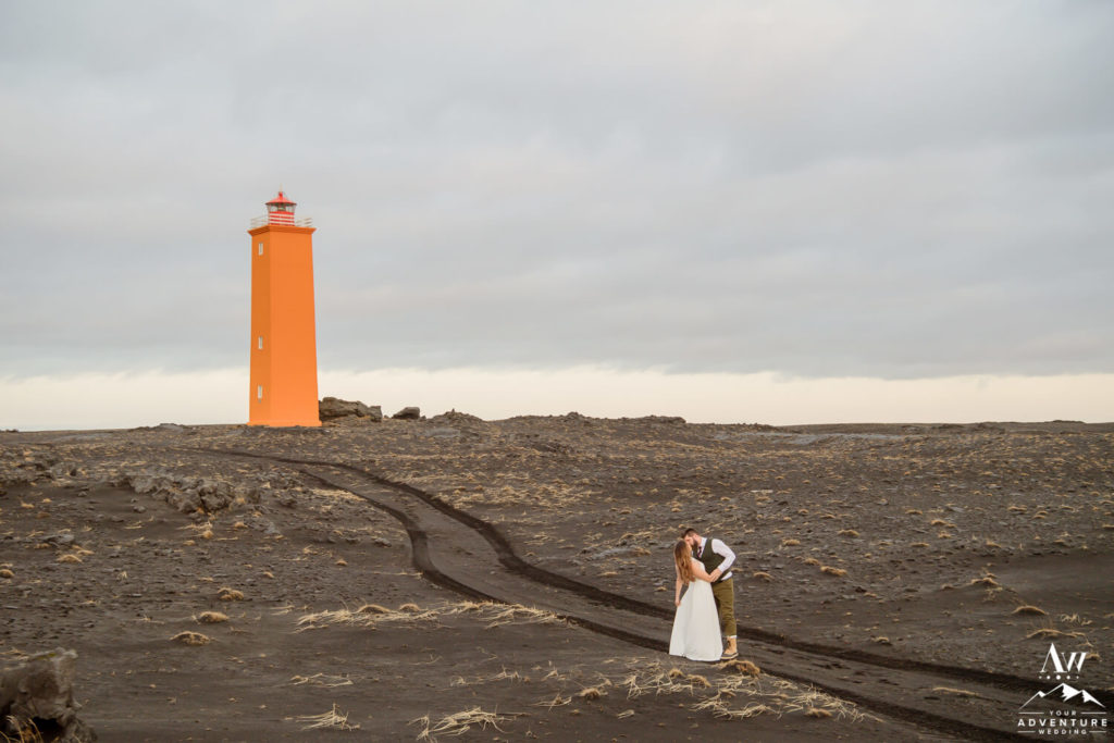 Iceland wedding couple at an orange lighthouse