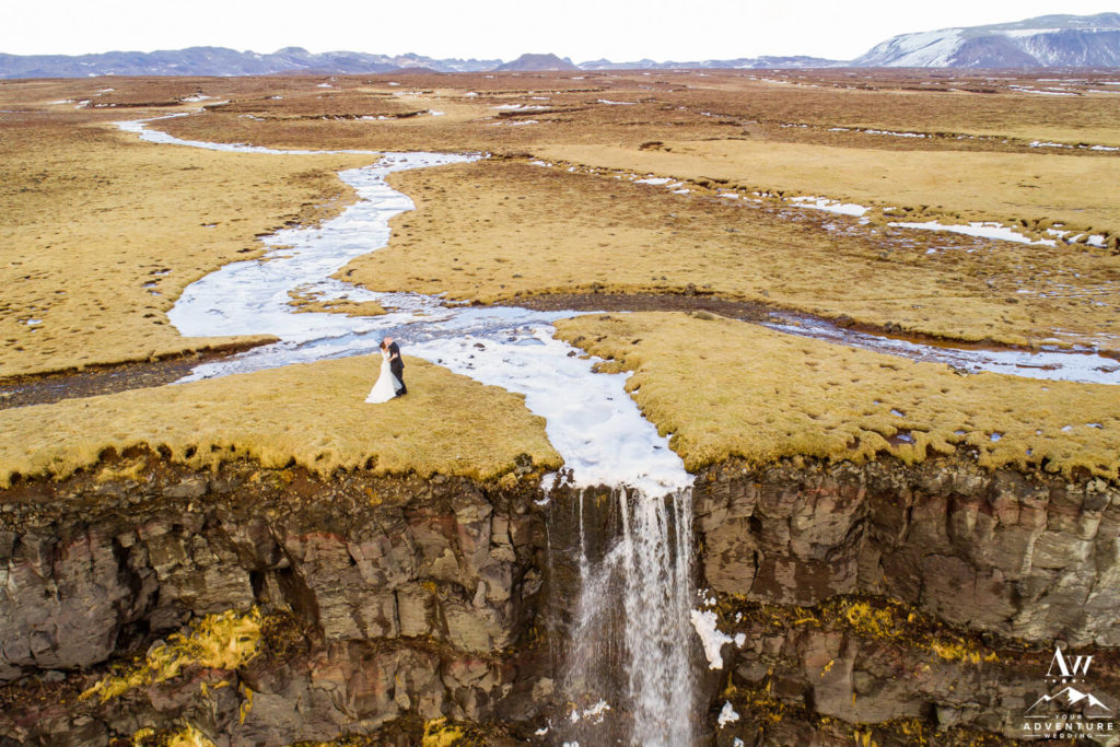 Iceland Adventure Elopement Couple on top a Waterfall