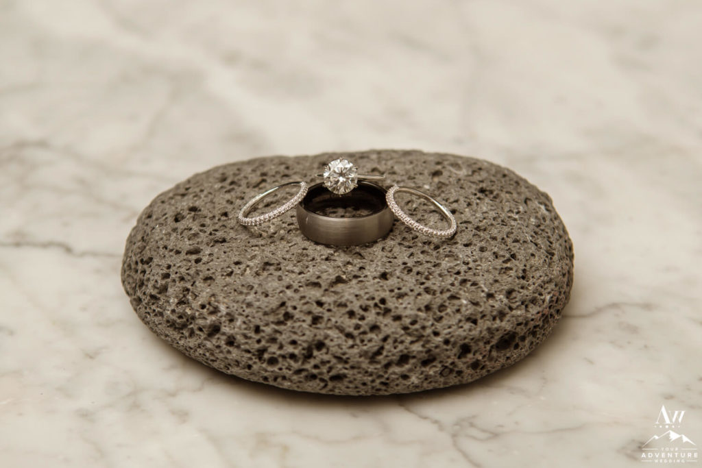 Iceland wedding rings on basalt rock