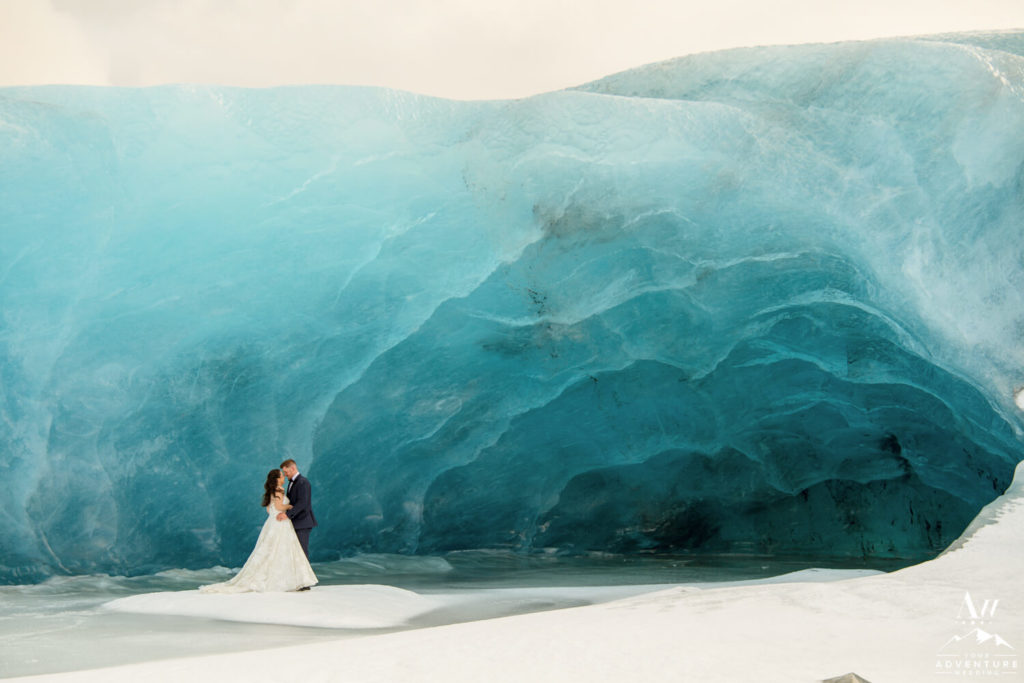 Iceland elopement couple in front of blue ice cave