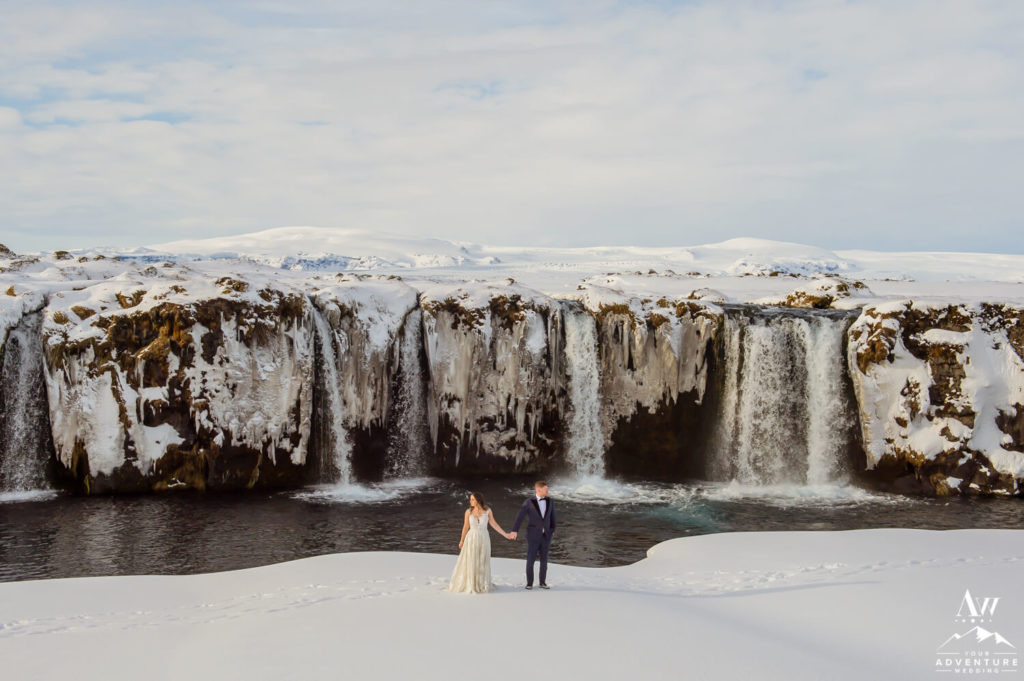 Iceland Honeymoon Adventure Couple Exploring a Waterfall