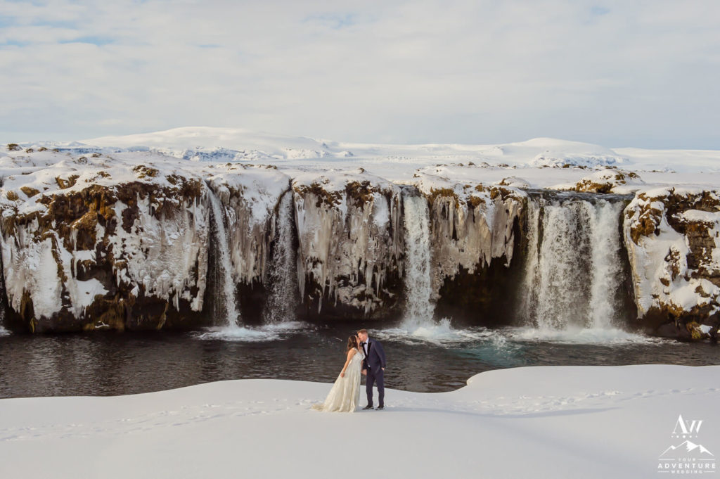 Iceland Honeymoon Adventure Session Couple in front of waterfall