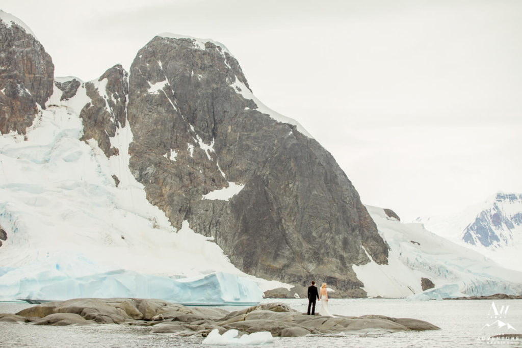 Antarctica Wedding Couple in front of Mountain