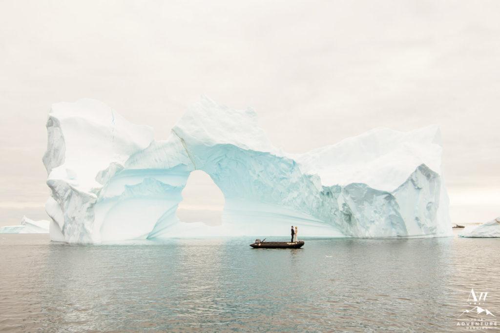 Antarctica Wedding Couple standing in front of iceberg