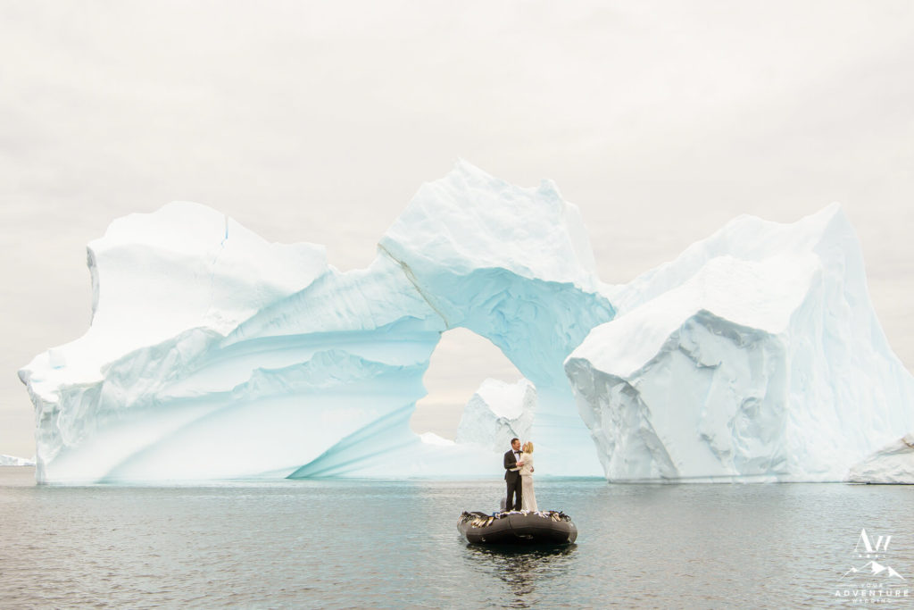 Arctic Weddings Versus Antarctica Wedding Couple in front of Iceberg