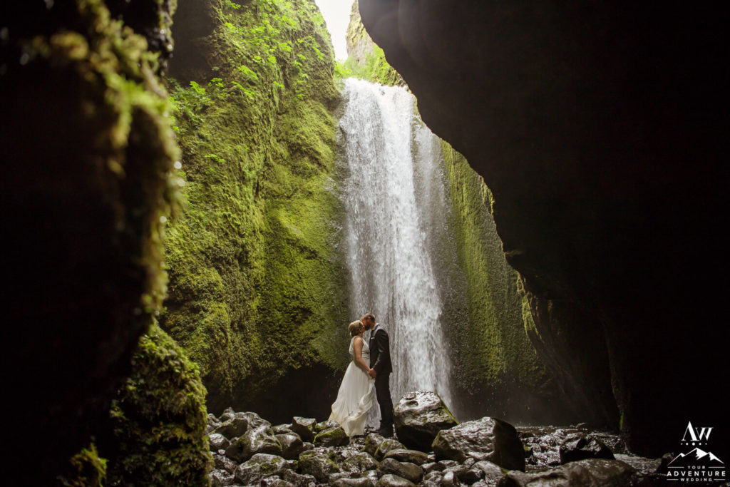 Iceland Elopement Couple kissing at Nauthúsagil Waterfall