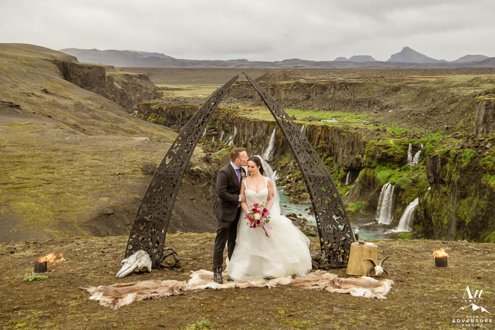 Iceland Elopement Couple at a waterfall and black arch