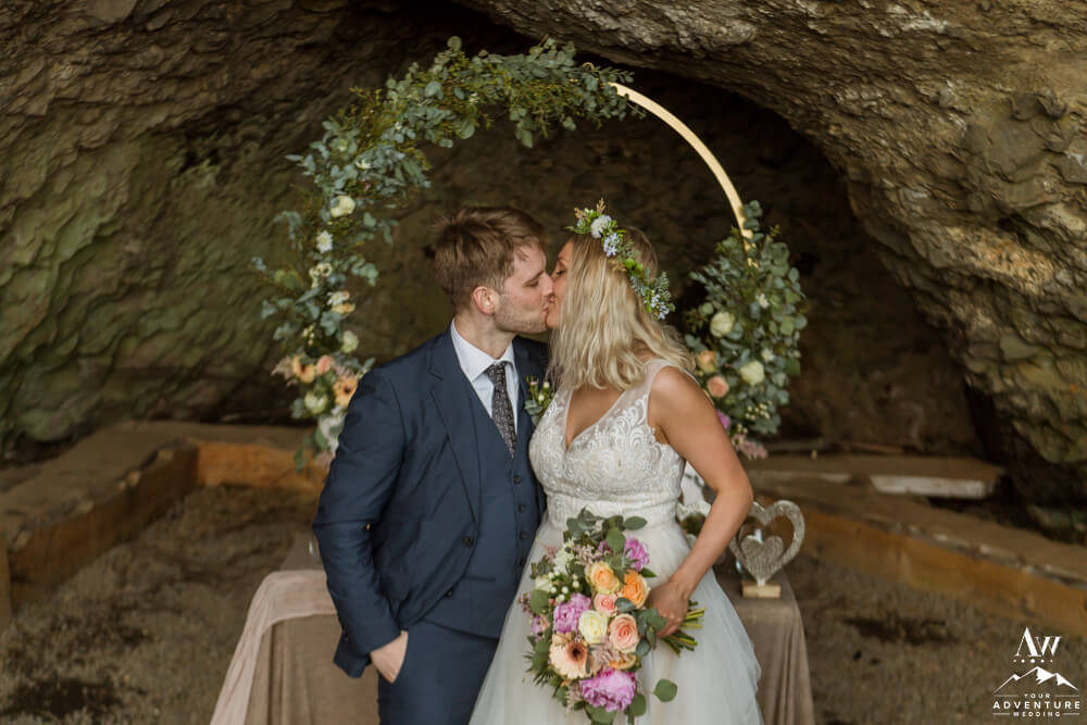 Iceland wedding couple kissing in a cave
