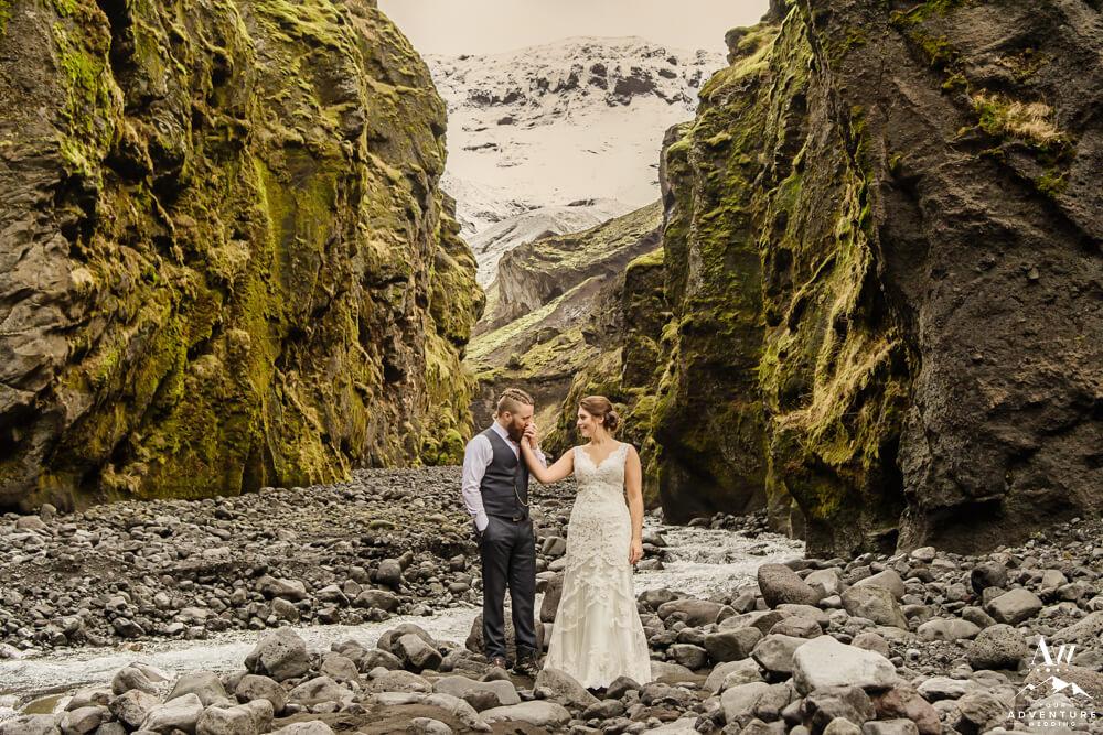 Groom kissing brides hand in Stakkholtsgjá
