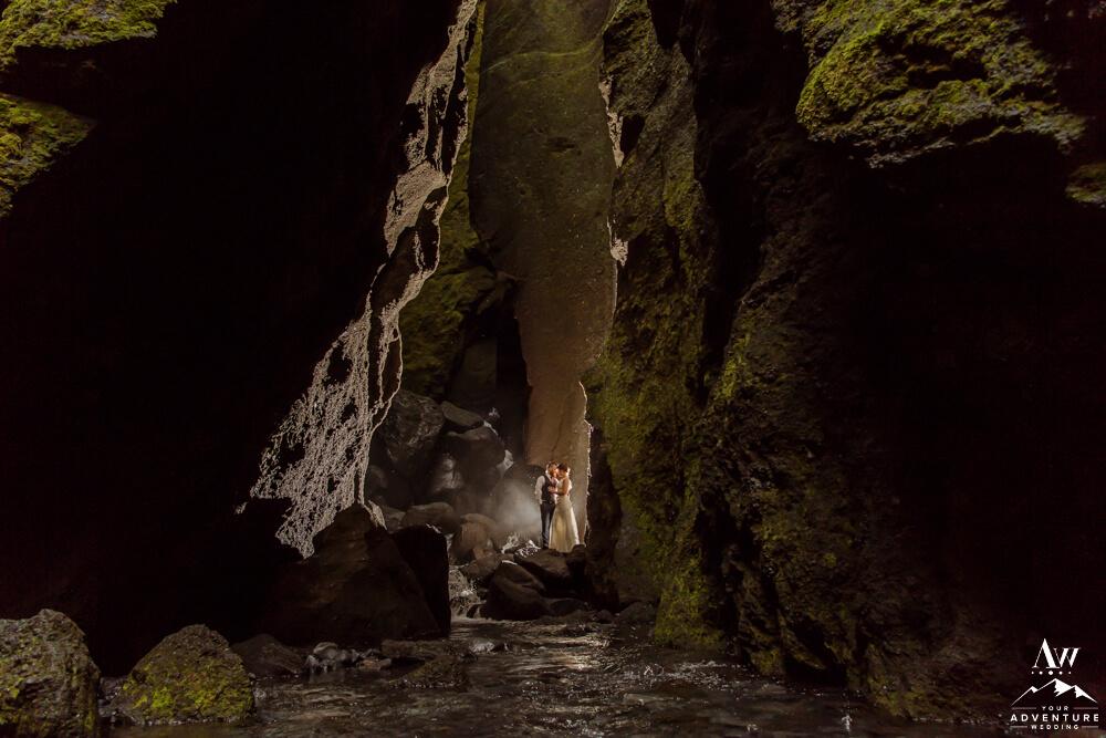 Hiking Elopement Couple inside Stakkholtsgjá Slot Canyon