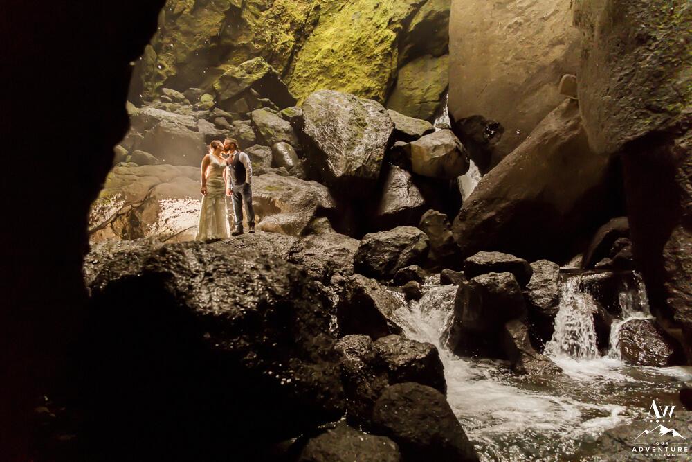 Iceland Wedding Couple kissing in Stakkholtsgjá Waterfall