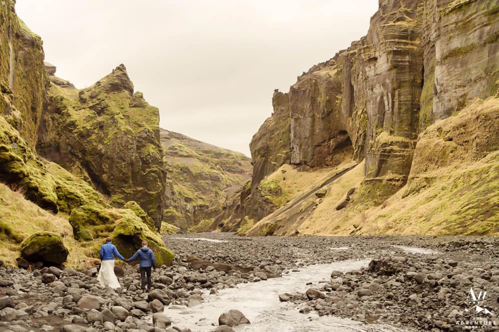 Iceland Wedding Couple hiking out of Stakkholtsgjá