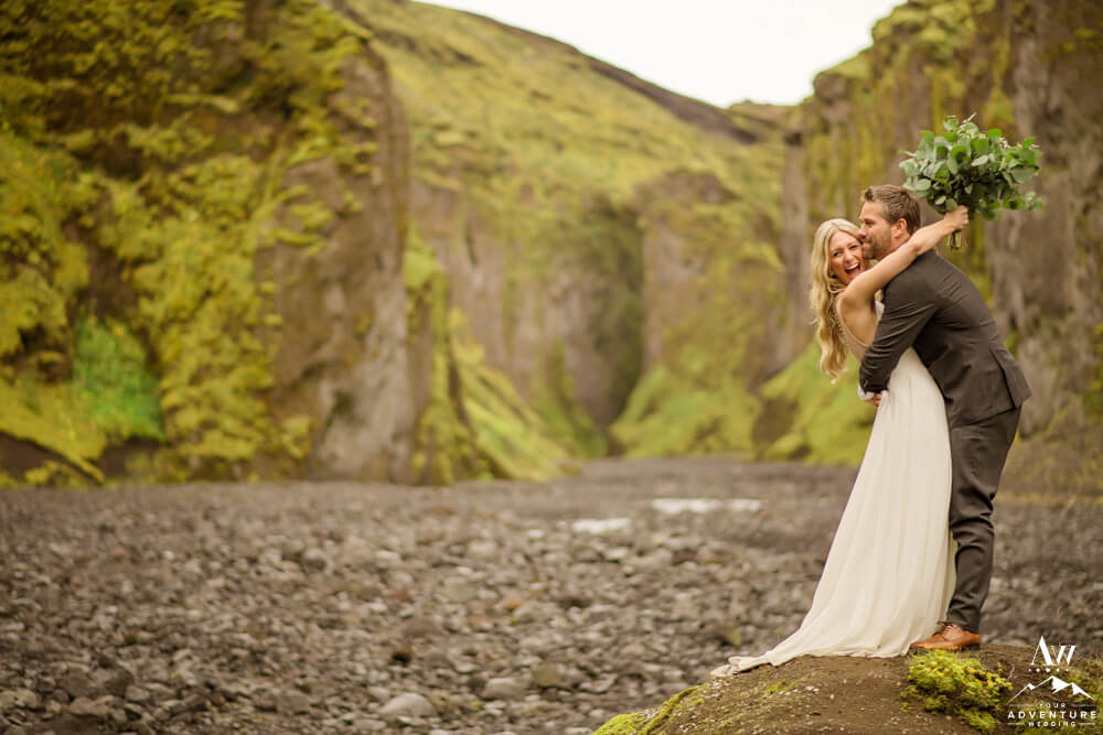 Couple eloping in Iceland laughing