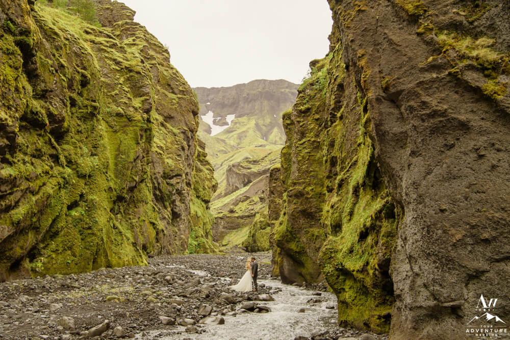 Iceland Elopement Couple kissing beside river Stakkholtsgja