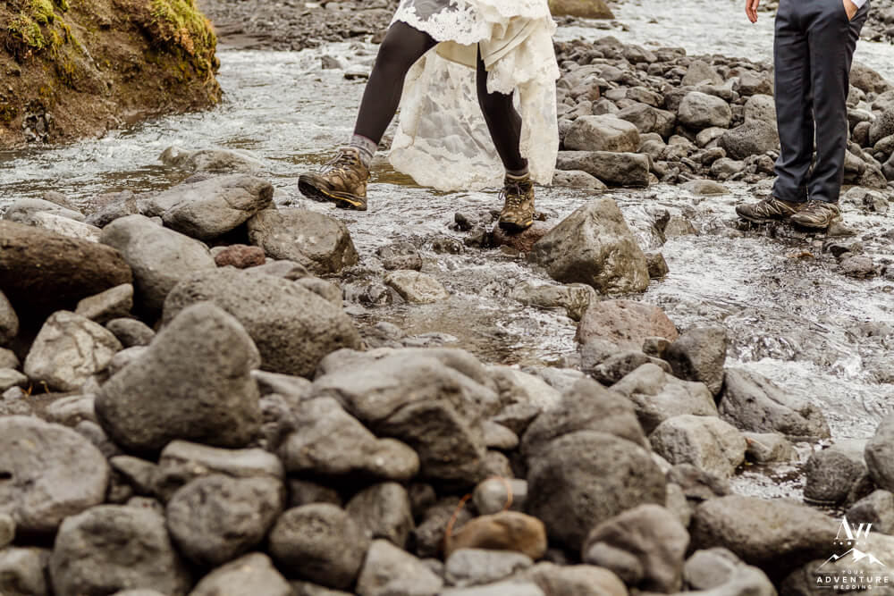 Iceland Elopement Bride hiking through a river