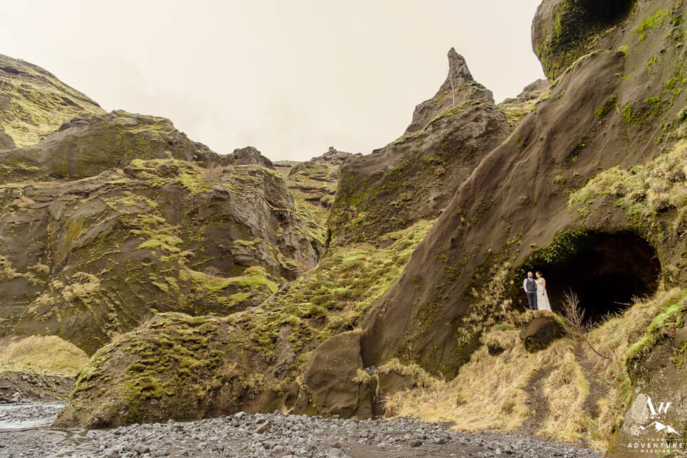 Iceland wedding couple standing in cave at Stakkholtsgjá