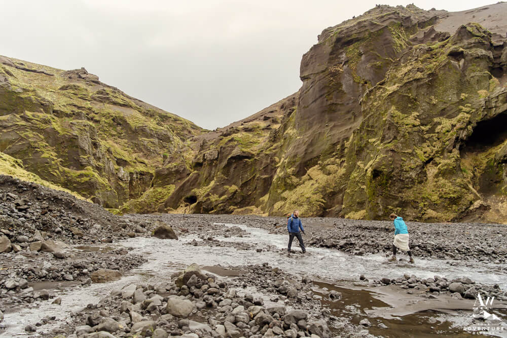 Iceland Elopement Couple hiking through river