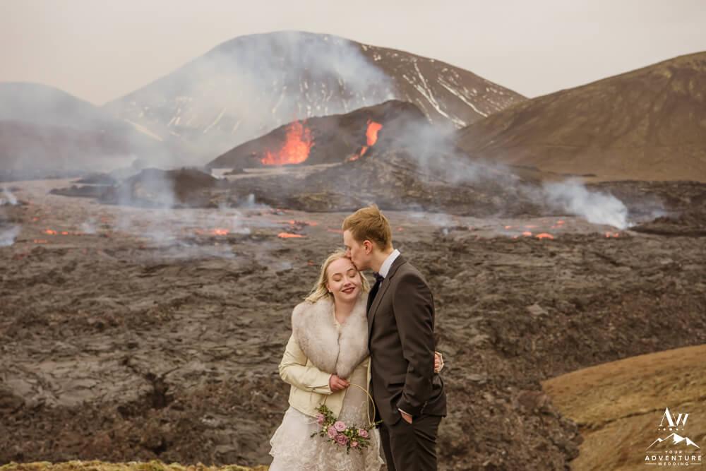 Groom Kisses Bride at Geldingadalir Volcano