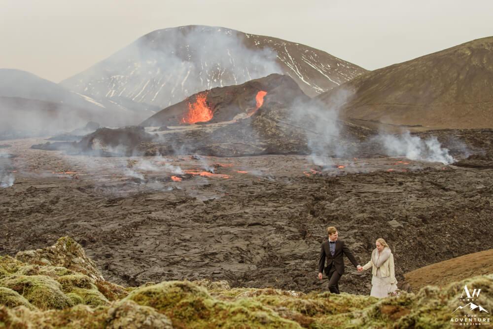 Iceland Wedding Couple walking with volcano behind