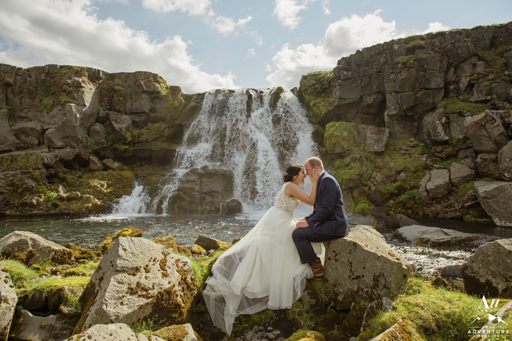 Iceland Honeymoon Photographer couple at waterfall