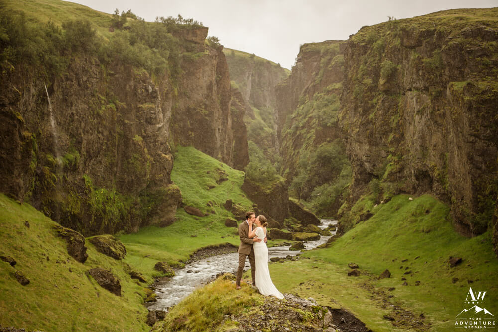 Iceland Elopement Planner - Couple Kissing in Canyon in Iceland